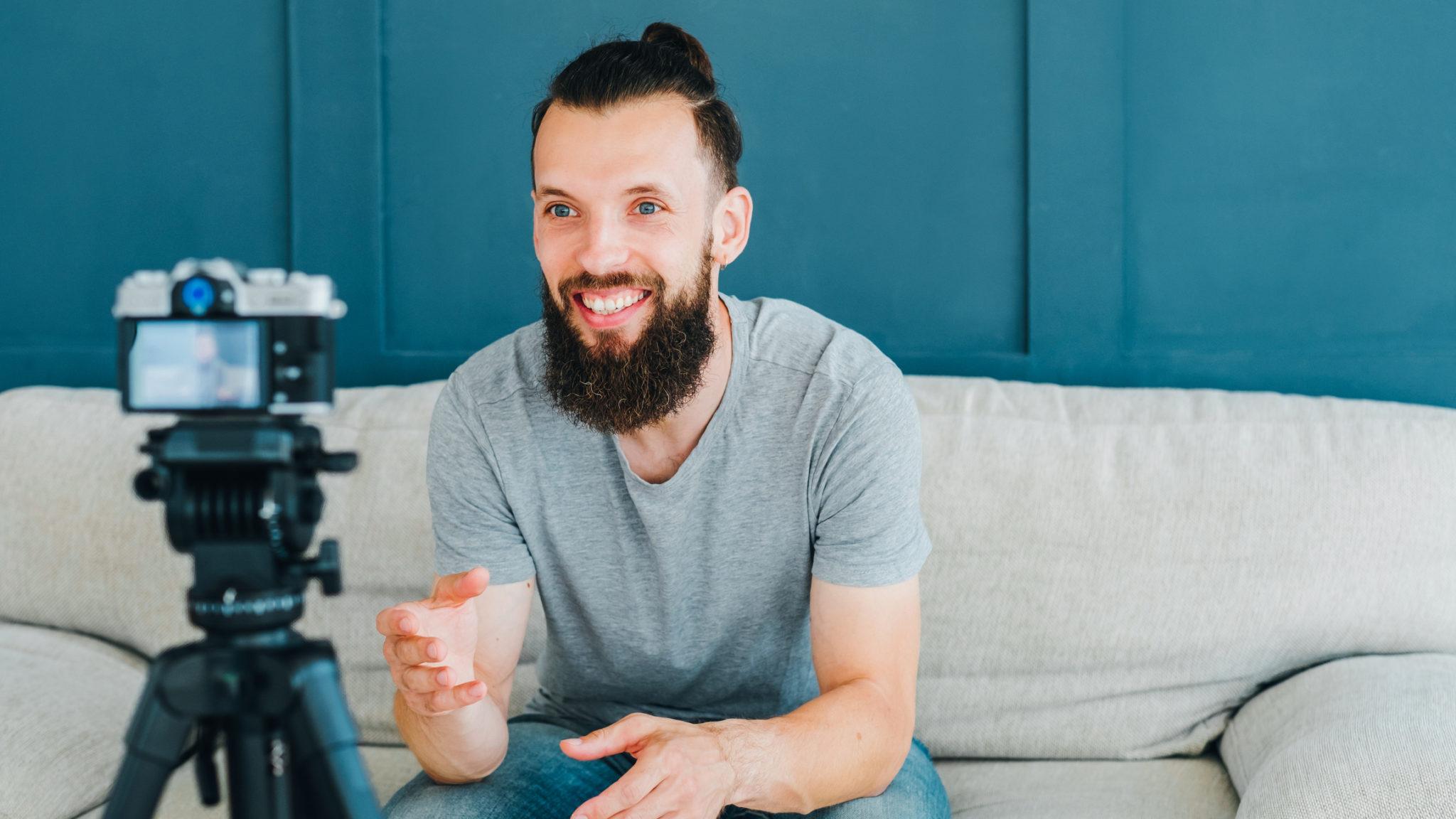 social media influencer smiling man shoot video